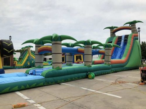 Tropical water slide and splash combo
